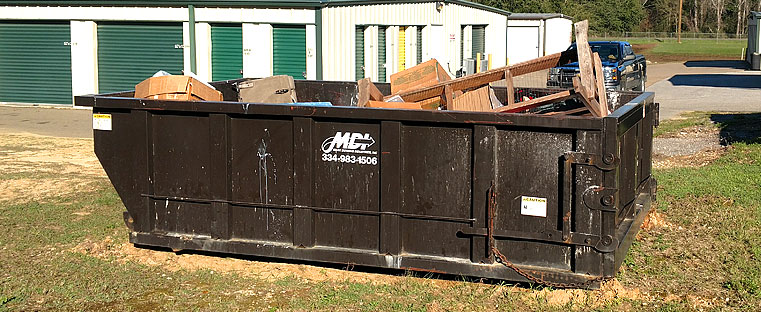 MDI 12 cubic yard roll-off container on site