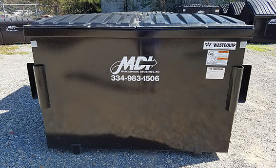 4 cubic yard MDI front load dumpster on site