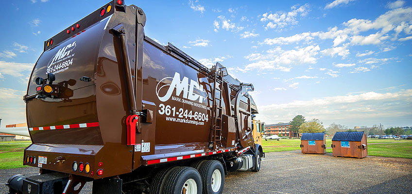 New MDI front load garbage and recycling truck preparing for pickup