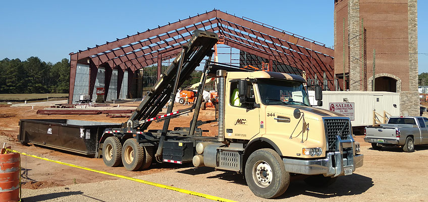 MDI Roll-off Truck and container drop-off on site