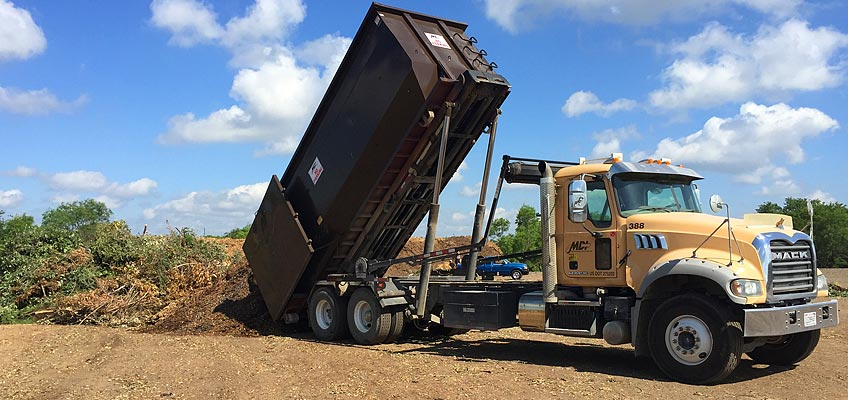 MDi roll-off container unloading at waste management site